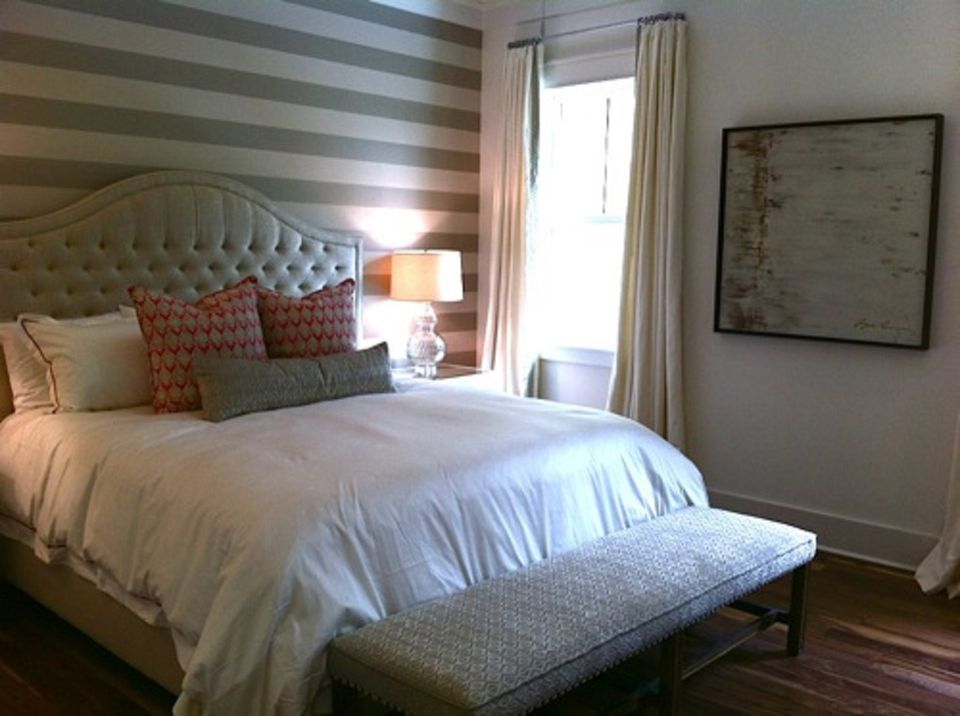 Bedroom with striped accent wall