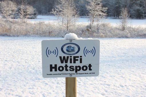 Wi-Fi hotspots sign in snow covered field