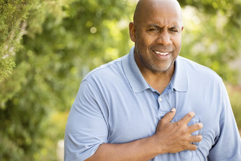 A man shows signs of a heart attack.