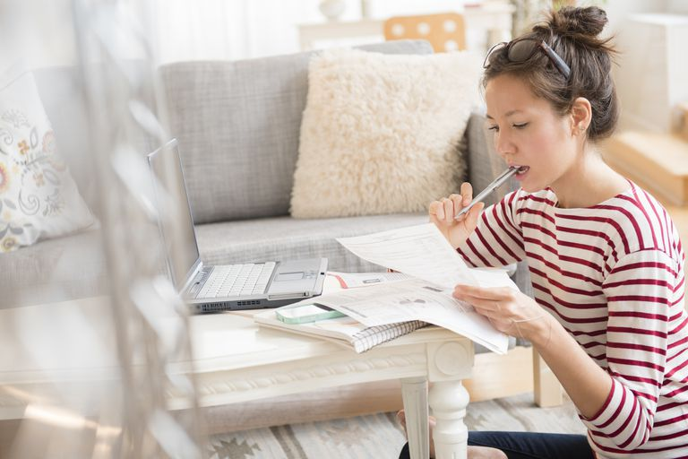 Woman reviewing finances at home