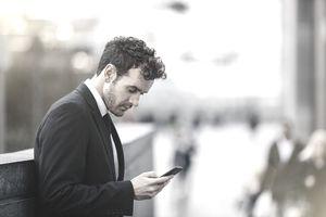 Businessman checking phone