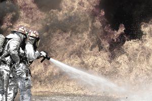 Firefighters combat a JP-8 jet fuel fire.
