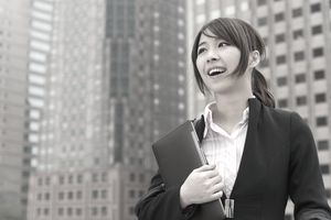 A woman standing among skyscrapers