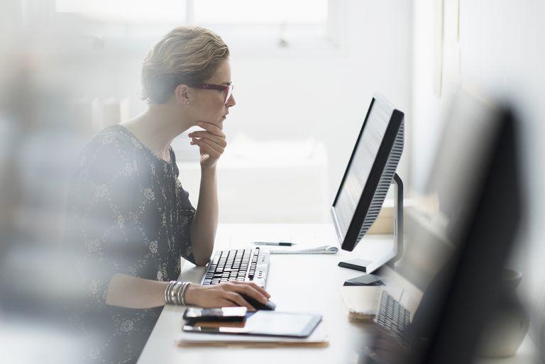 Woman working on desktop computer