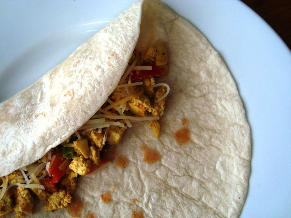 Tofu scramble with cheese on a tortilla