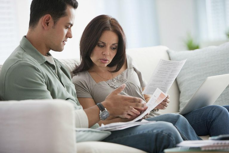 Couple reviewing monthly bills
