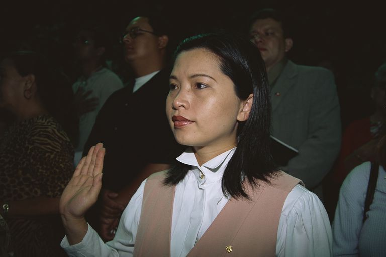 Woman Pledging During Naturalization Ceremony