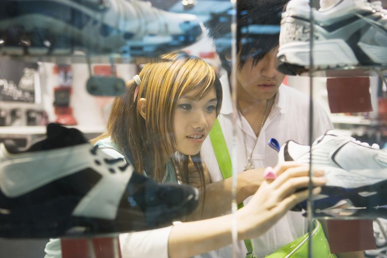 Young couple looking at sports shoes in store