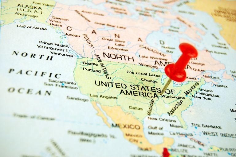 A push pin fixed over map of USA. High depth of field.