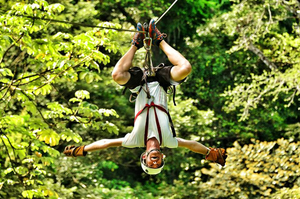 Full length of young man on zip line.