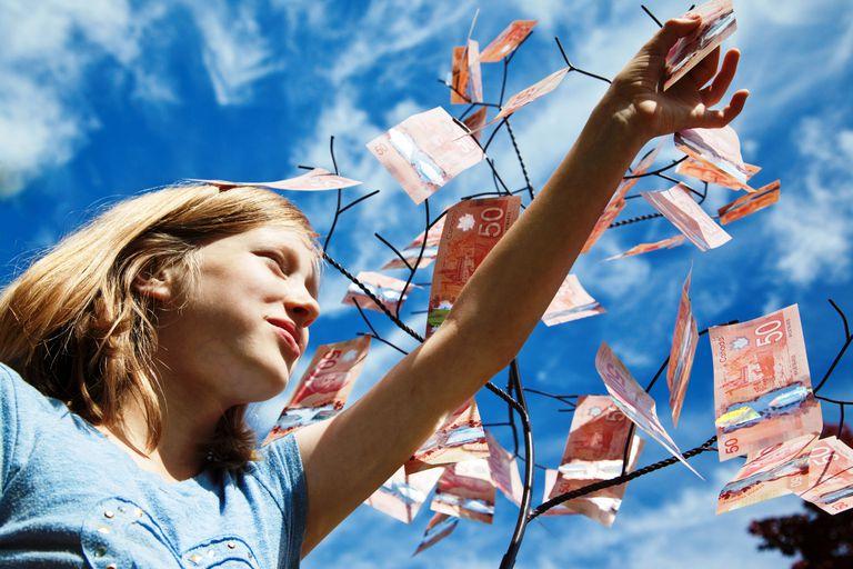 A girl picking Canadian 50 dollar bills.