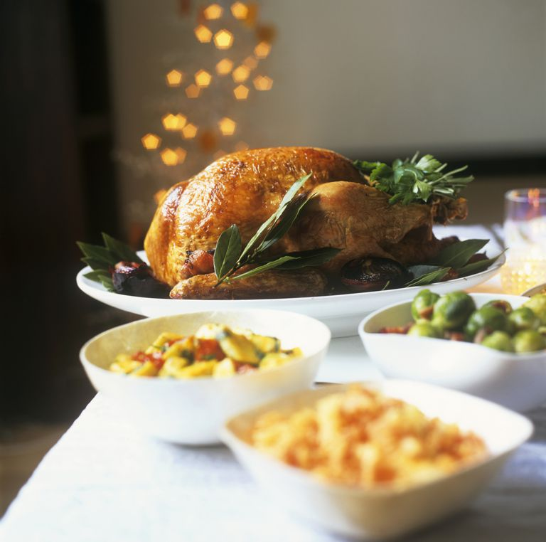 Stuffed turkey with accompaniments on dining room table