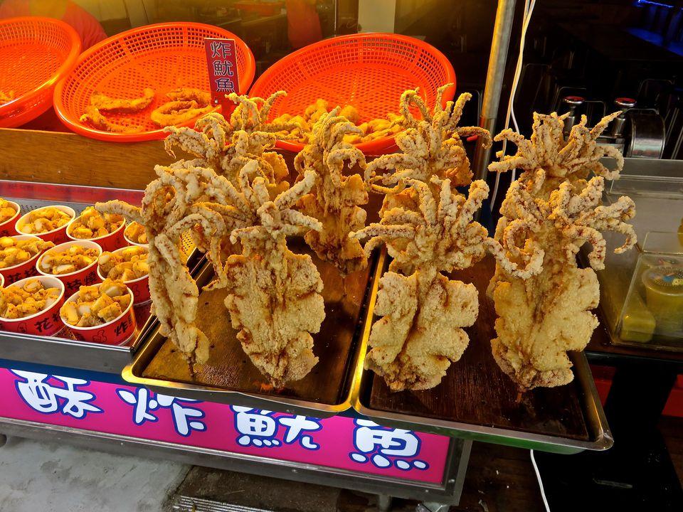 Deep Fried Calamari On Skewers On Market Stall