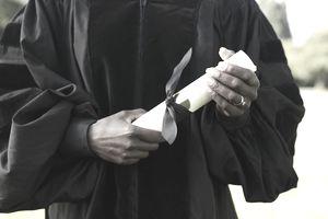 a graduate student holding a graduation certificate