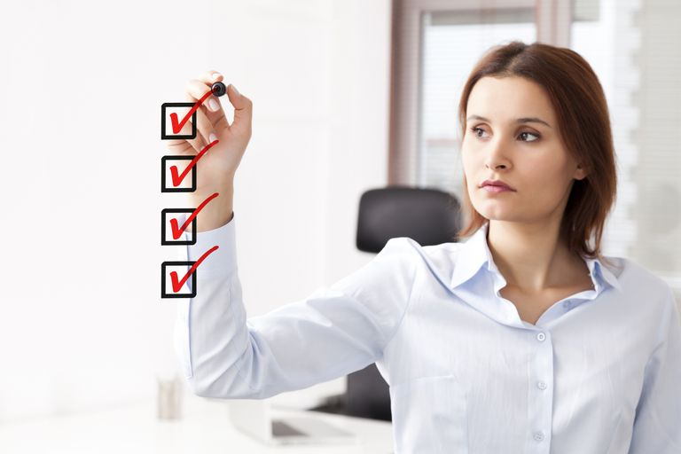 Woman making an HR checklist