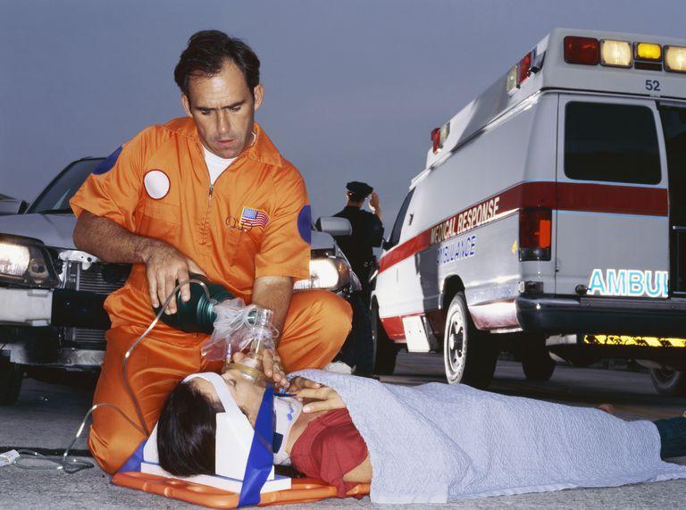 paramedic ventilating patient