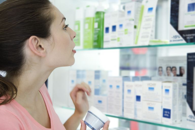 Young woman browsing beauty products in store