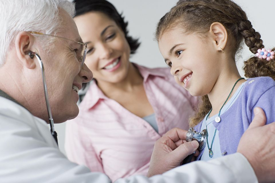 Doctor examining girl (10-11)
