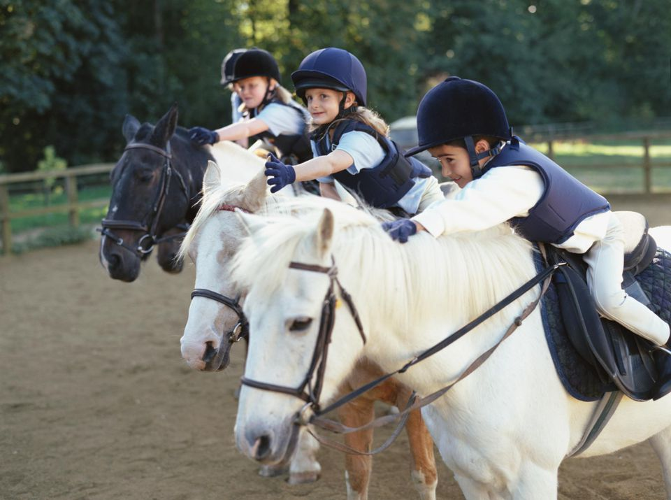 children riding ponies