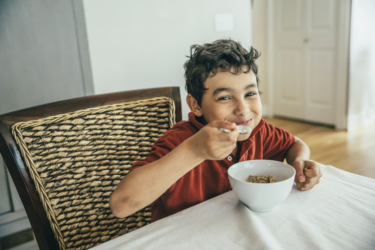 Boy eating cereal for quick breakfast