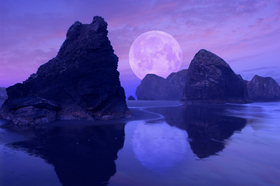 Moon over rock formations on beach, Gold Beach, Oregon, United States