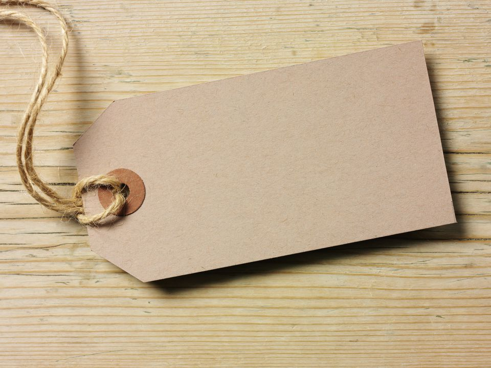 Brown gift tag on pine table
