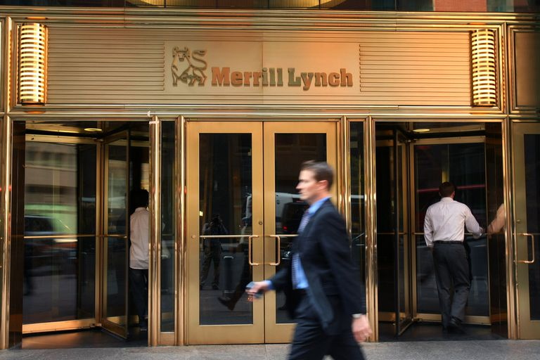Pedestrians walk past Merrill Lynch offices in New York City