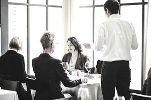 Group of businesswomen meeting in restaurant