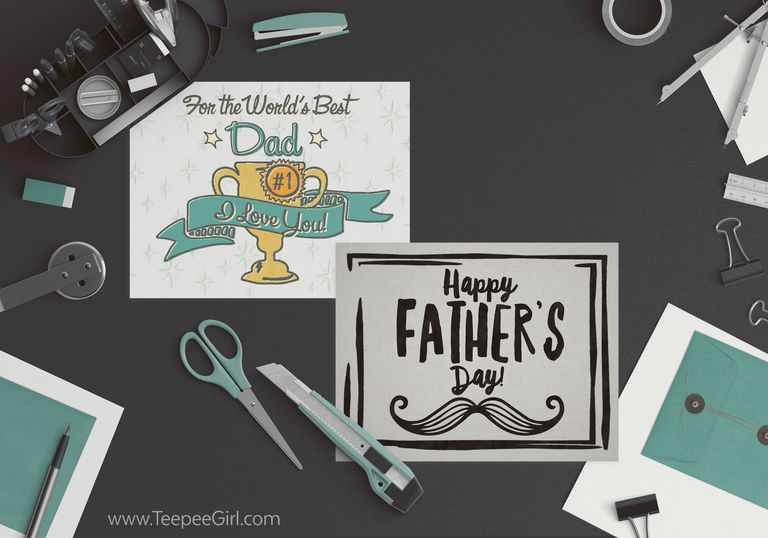 Two Father's Day cards laying on a table