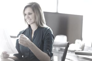 Young woman reviewing resume