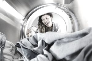 Woman Getting Clothes Out of Dryer