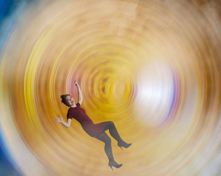 Photo of a woman spinning in vertigo.