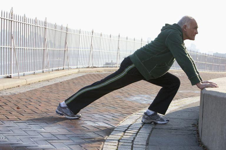 senior man stretching for exercise