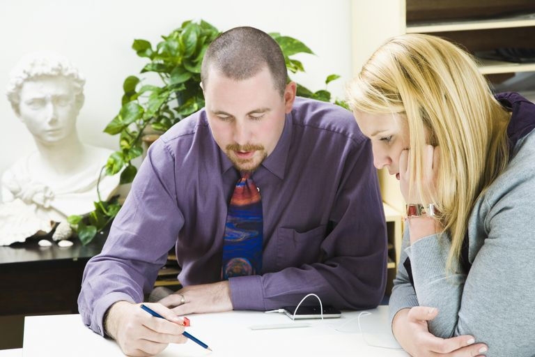 Professor guiding his student
