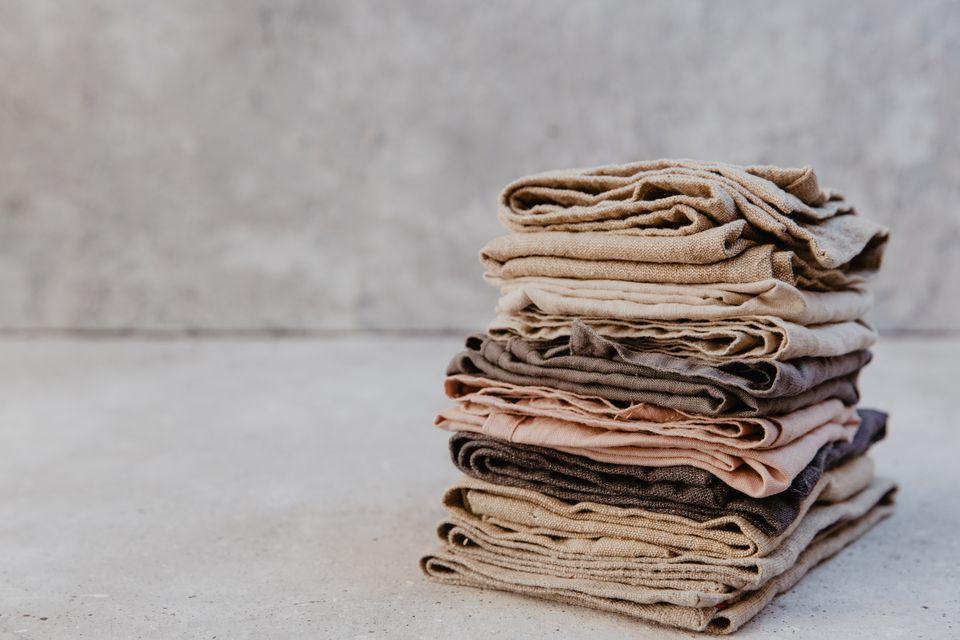 Rustic linen kitchen napkins on a light background. Pastel shades
