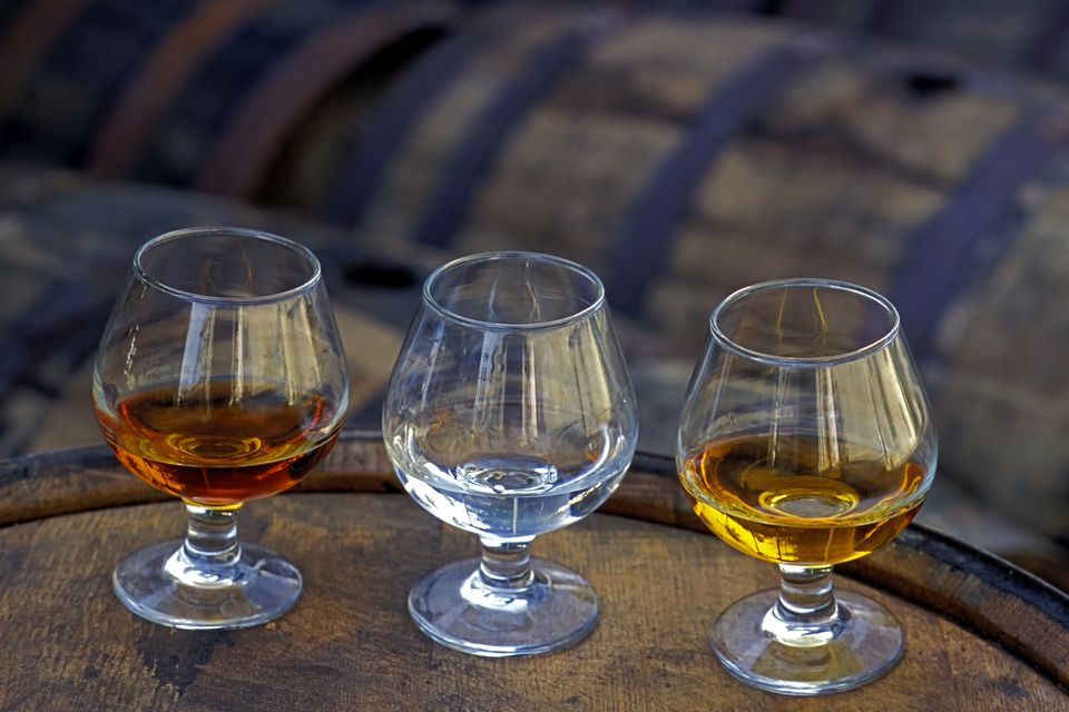 Three glasses of rum: light, gold, and aged.