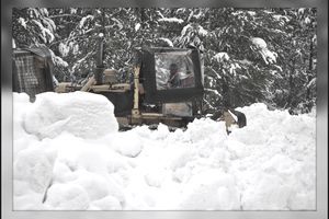 tractor immersed in snow