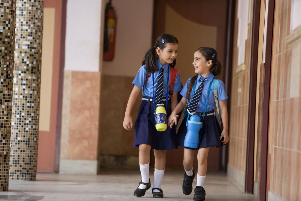 School girls walking together with water bottles