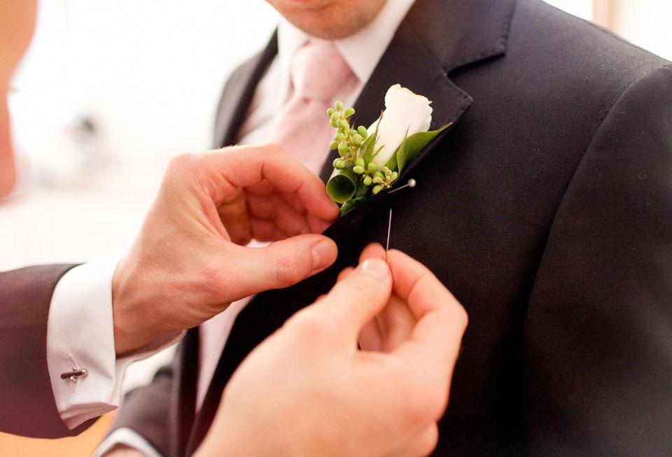 Groomsman pinning corsage