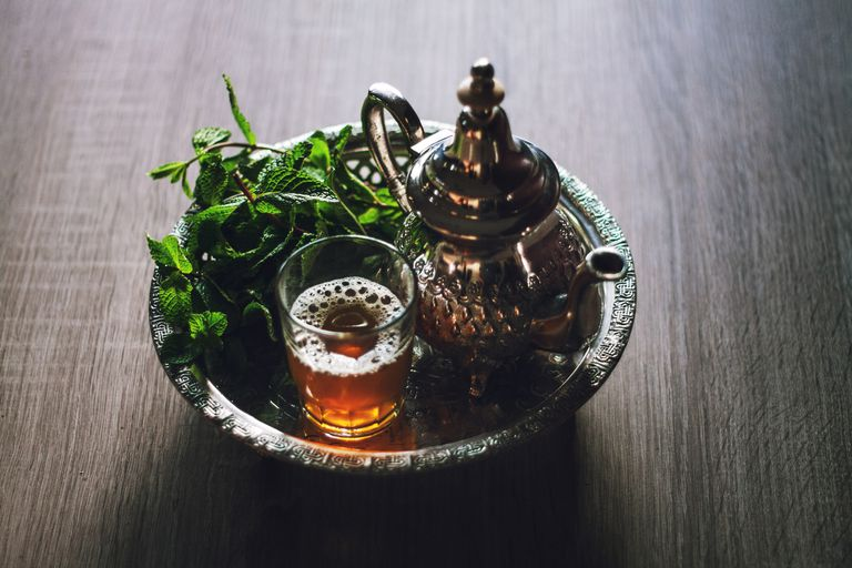 High Angle View Of Tea And Teapot In Tray On Table