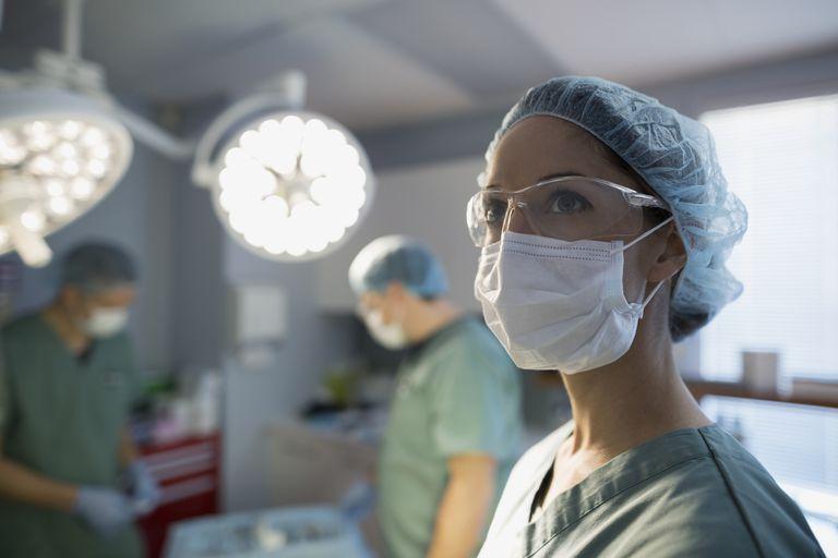 Pensive surgeon looking away in operating room