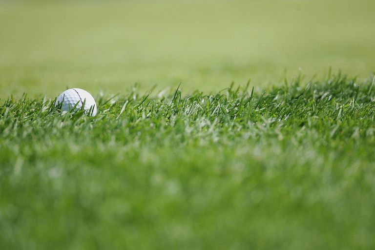 Golf ball sits in the rough during the final round of the Omega European Masters tournament