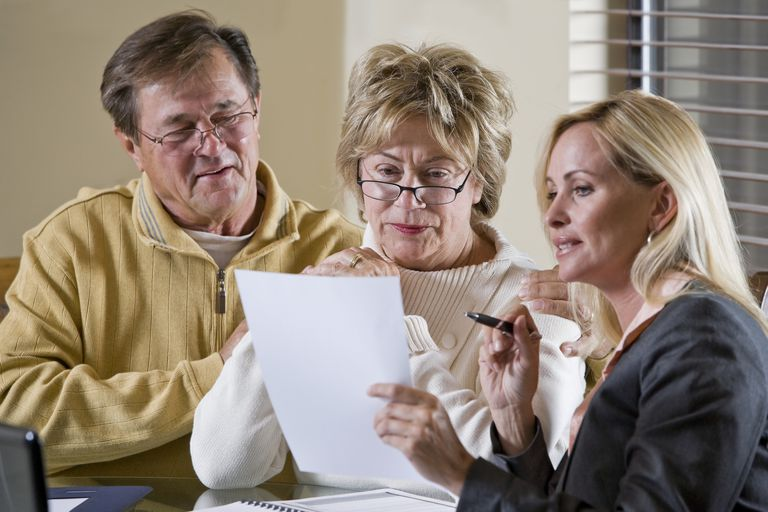 Senior couple talking with financial planner or consultant Senior couple talking with financial planner, consultant or insurance agent, getting advice.