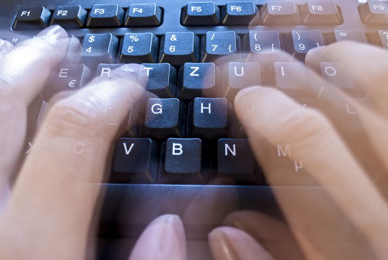 Fast hands typing on keyboard