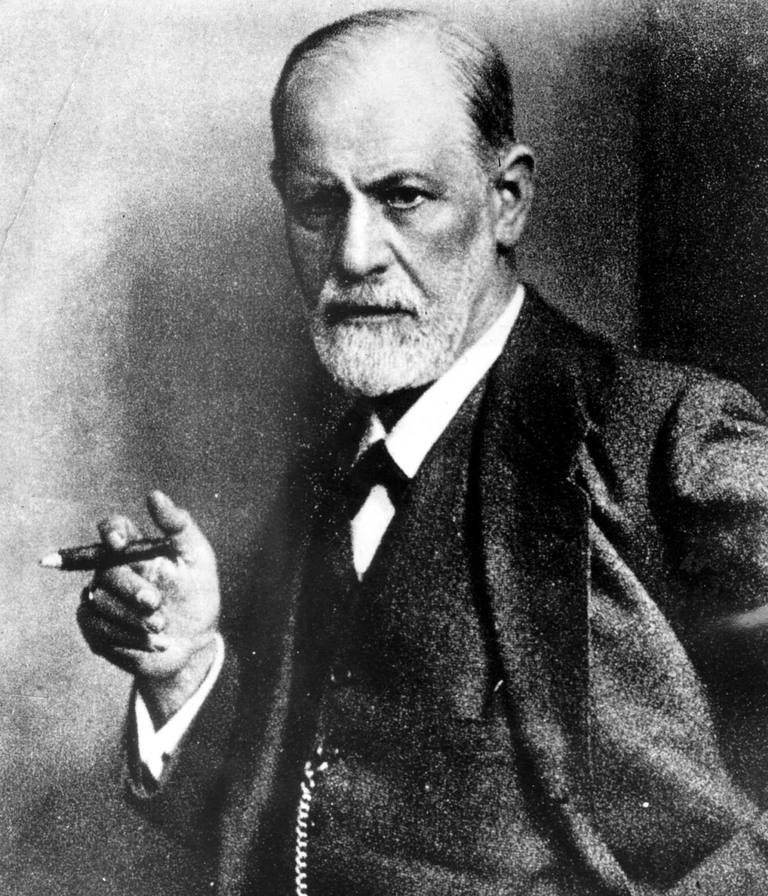 Picture of psychoanalyst Sigmund Freud smoking a cigar.
