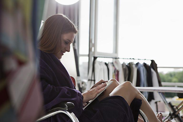 Model using tablet computer at shoot