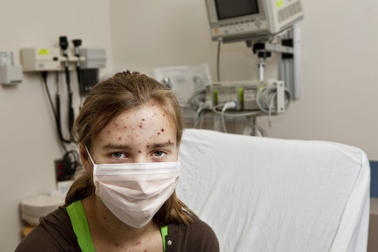 Girl with Chickenpox in Isolation Room