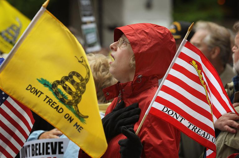 Kay Herrmann sings the National Anthem at the start of a Tea Party rally which was held to protest President Barack Obama's proposed 'Buffett rule' tax plan