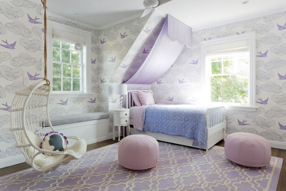 Purple and white girl's room with DIY slide canopy made from curtain rods