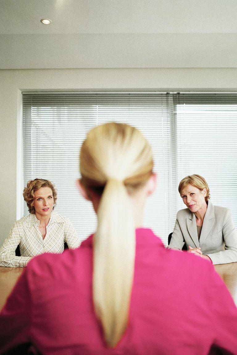 Three businesswomen in discussion (focus on women in background)